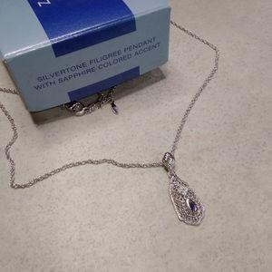 Silver tone Filigree Pendant Sapphire color Accent